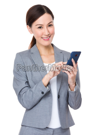 asian, businesswoman, use, of, mobile, phone - 14093423