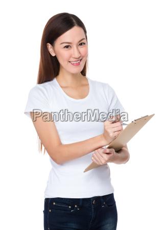 woman, write, on, clipboard - 14093341