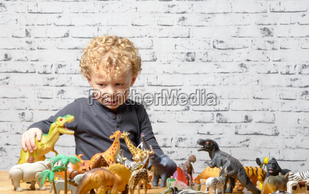 a, little, child, plays, with, toys - 14100325