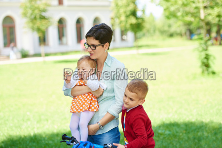 happy, young, family, in, park - 14104889