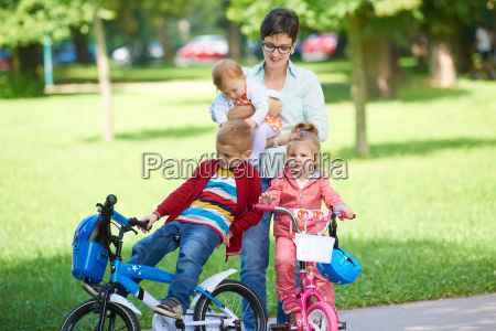 happy, young, family, in, park - 14104903