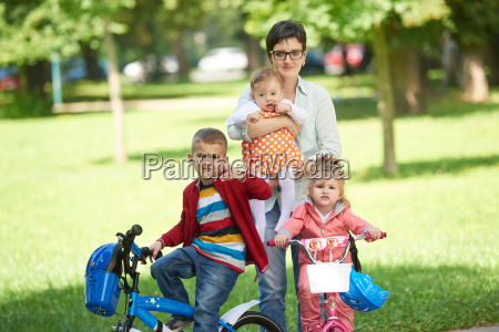 happy, young, family, in, park - 14104913