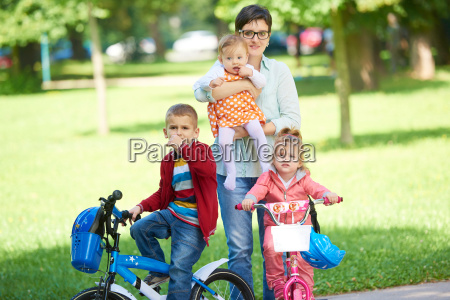 happy, young, family, in, park - 14104915