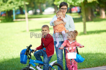 happy, young, family, in, park - 14104917