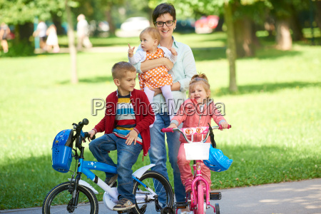 happy, young, family, in, park - 14104919