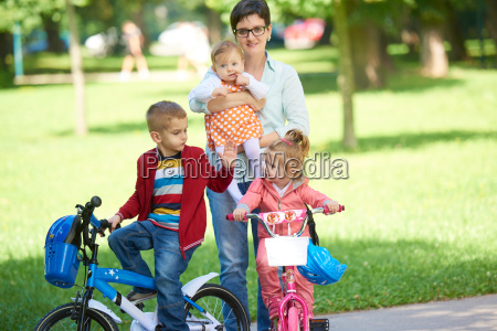 happy, young, family, in, park - 14104921