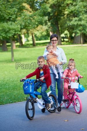 happy, young, family, in, park - 14104937