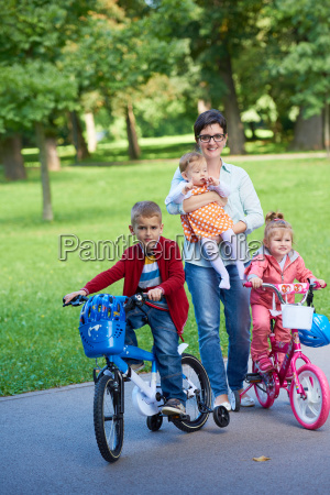 happy, young, family, in, park - 14104941