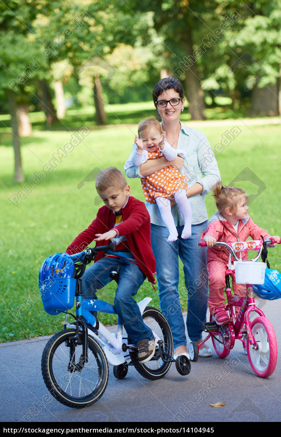happy, young, family, in, park - 14104945