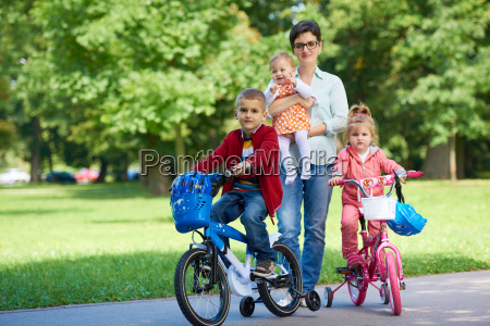 happy, young, family, in, park - 14104947