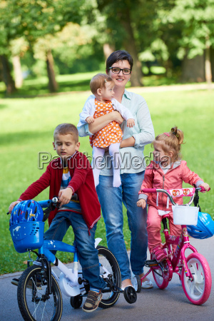happy, young, family, in, park - 14104959