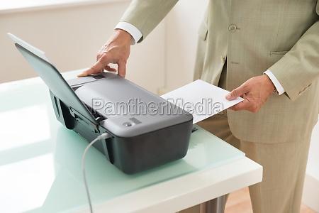 businessman using scanner