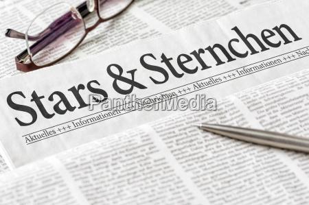 newspaper headlined stars and asterisks