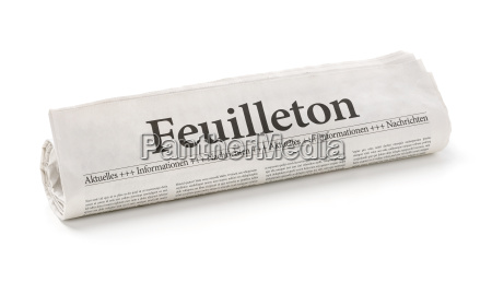 newspaper roll with the headline feature