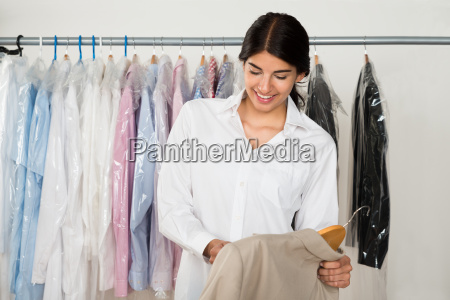 young female in clothes store