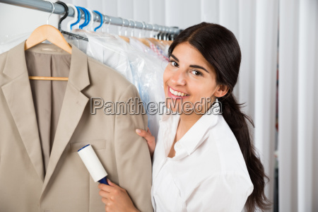 cleaner in laundry shop with adhesive