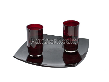 two claret glasses on a black