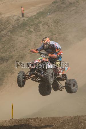 quad rider in a high jump