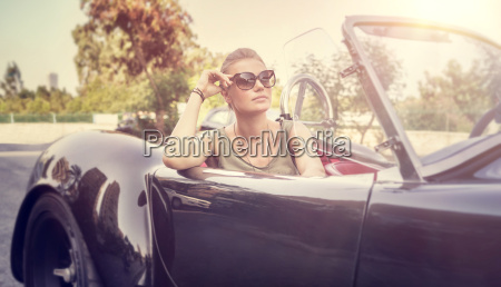 beautiful woman in cabriolet
