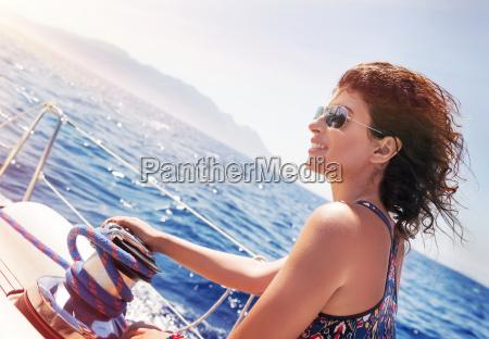 beautiful woman on sailboat