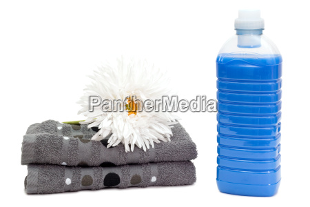 detergent with towels and flower