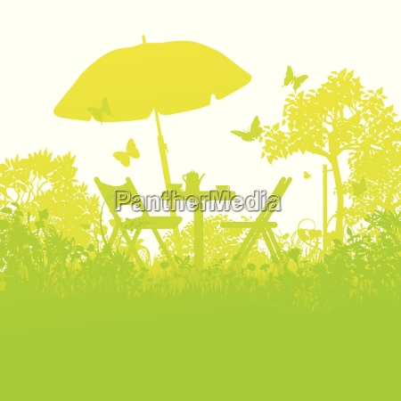 two garden chairs with umbrella in