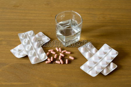 tablets and water glass on a
