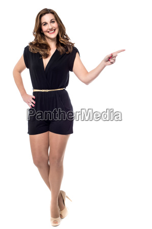 woman showing direction full length