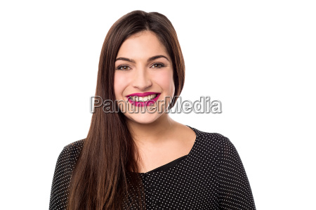 smiling woman giving a casual look