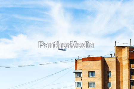 transport aircraft over urban house