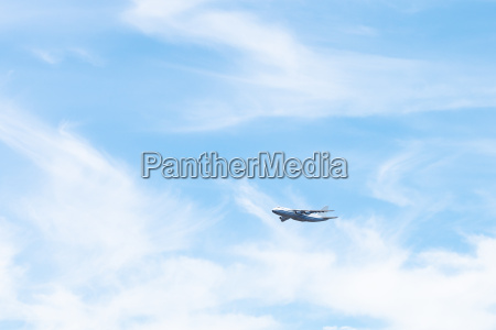 transport aircraft in white clouds