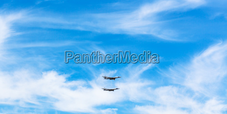 two strategic bomber airplanes in white