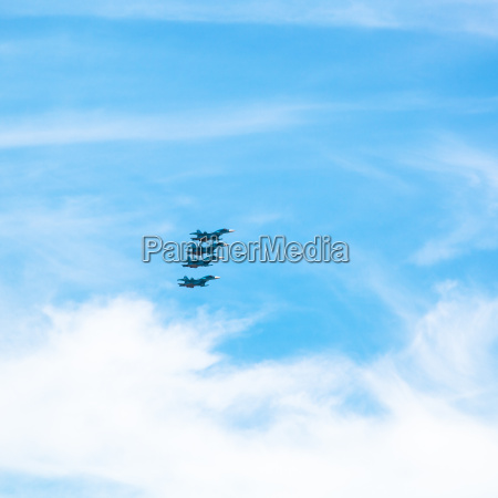 green military fighter aircrafts in cloudy