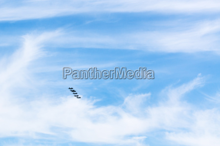 sky with white clouds and military