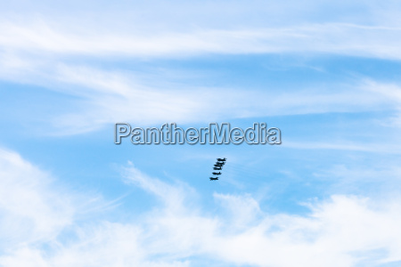 blue sky with clouds and military