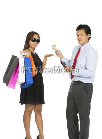 asian woman shopper accepting money husband