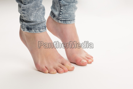 two bare feet standing tiptoe on