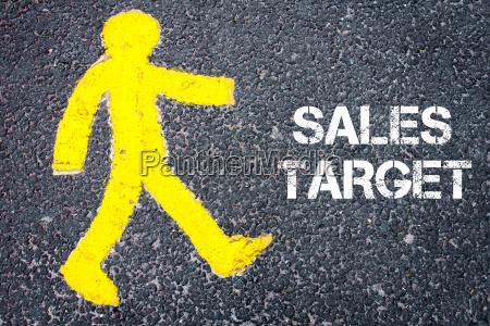 yellow pedestrian figure walking towards sales