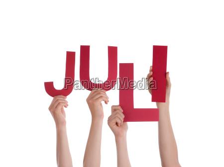 people holding german word juli means