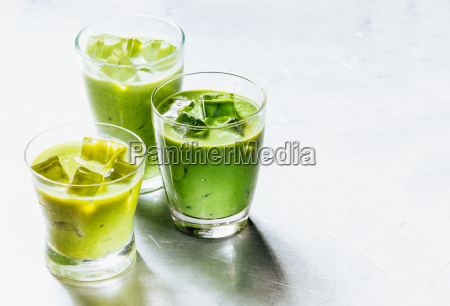 healthy green smoothie shakes in drinking