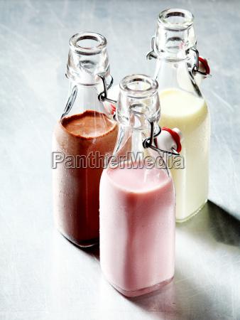 blended smoothie shakes in glass bottles