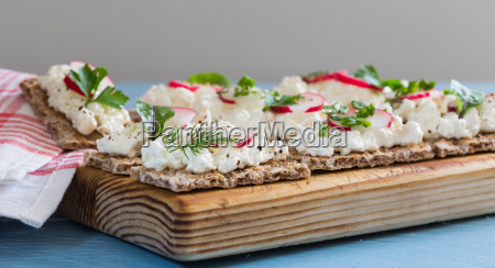 crispbread with cottage cheese radishes and