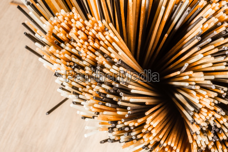 three different colours of spaghetti from