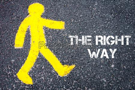 yellow pedestrian figure walking towards the