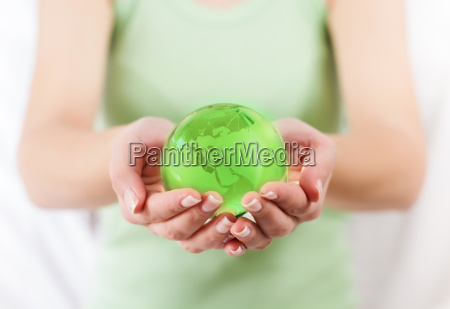 green earth globe in human hands