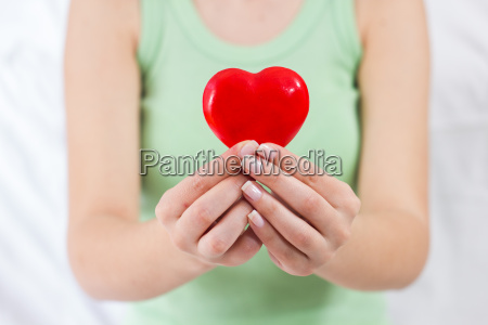 red heart shape health love support