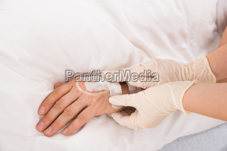 iv drip in patients hand