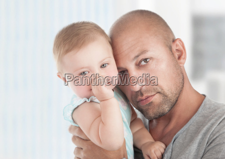 gentle father with little daughter