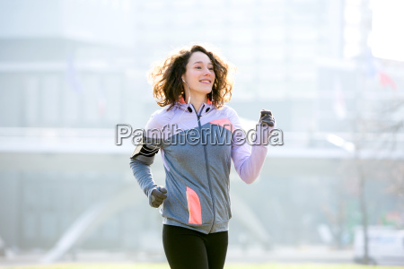 young attractive woman running at the