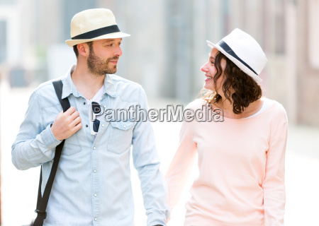 young couple visiting city during holidays